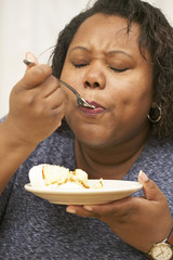 African American enjoying a piece of cake