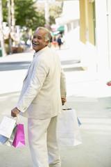 Smiling Hispanic man shopping