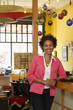 African American small business owner standing in shop