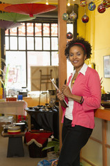 African American small business owner working in shop