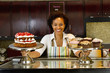 African American bakery owner displaying baked goods