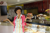 African American bakery owner standing in shop