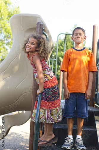 Mixed race children playing on playground