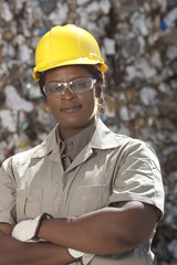 Black sanitation worker in recycling plant