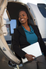 African American businesswoman leaving private jet