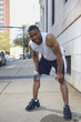 African American man leaning over after exercise
