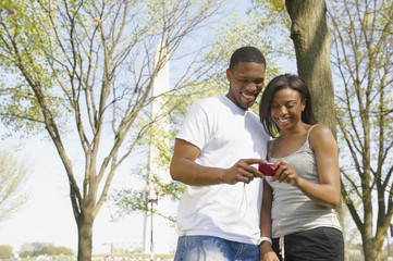 African American couple looking at camera in park