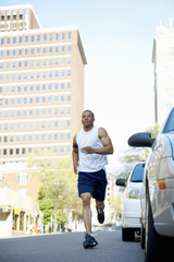 African American man running on city street