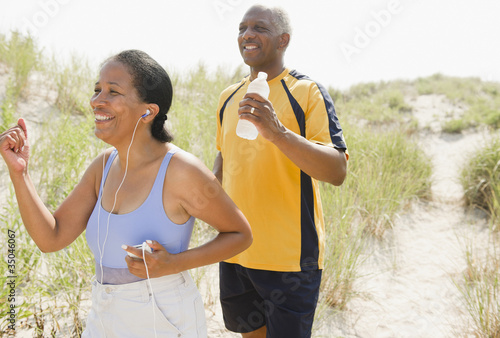 Black couple exercising on beach