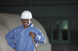 Black worker in hazmat suit and hard-hat