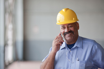 Hispanic worker talking on cell phone