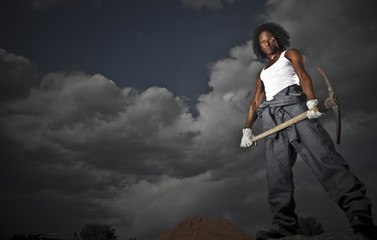 Black construction worker with pickax