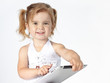 Adorable little girl has a lot of fun with touchpad