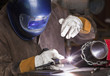 Mixed race machinist working at arc welding