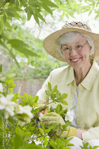 Mixed race woman working in garden