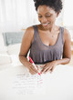 Black woman checking off to do list
