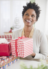Black woman holding wrapped gift
