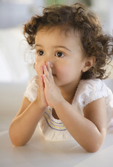 Mixed race girl praying