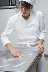 Baker working in bakery kitchen