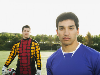 Soccer players standing on soccer field