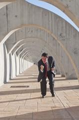 Hispanic businessman cheering at success