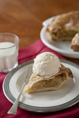 Apple pie al a mode with glass of milk