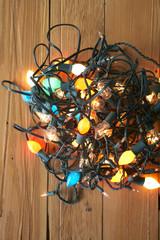 Glowing Christmas lights tangled on floor