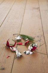 Broken Christmas ornament on floor