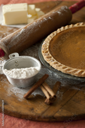 Baking ingredients and homemade pumpkin pie