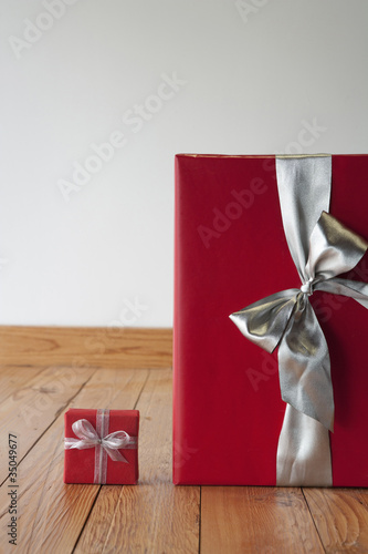Large and small Christmas gifts on floor