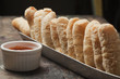Bread in basket and dipping sauce