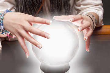 Mixed race fortune teller with crystal ball
