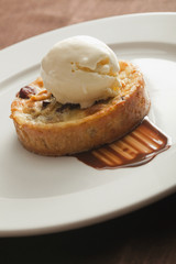 Close up of tart and ice cream on plate