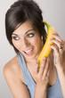 Beautiful Brunette holds a Banana