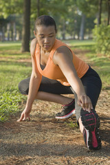 African American woman stretching before exercise