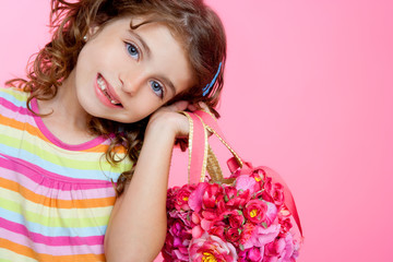 children girl holding fashin spring pink flowers bag
