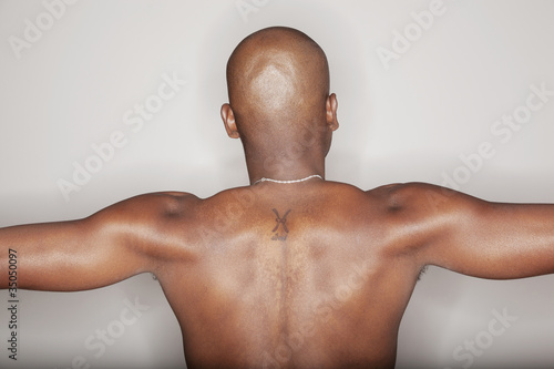 Tattoo on African American man's back