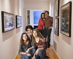Family standing in corridor together