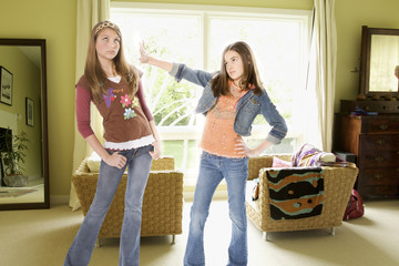 Sisters arguing in living room