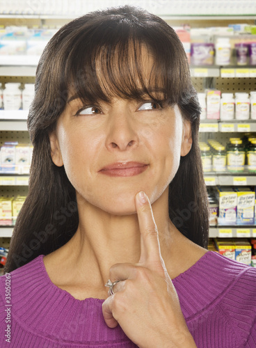 Hispanic woman in drug store