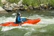 Caucasian girl kayaking in river