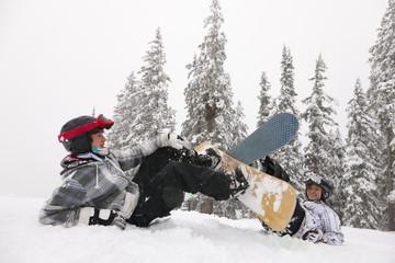 Snowboarders falling