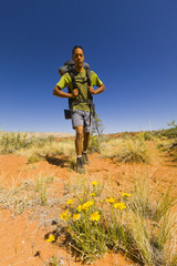 Black man hiking in desert