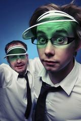 Caucasian businessmen wearing poker visors