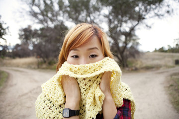 Korean woman covering  her face with scarf