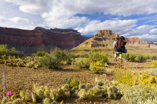 Black man hiking in canyon area