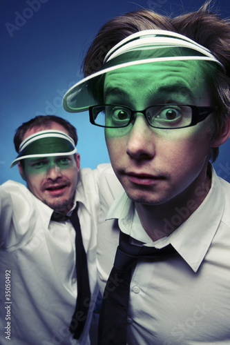Caucasian businessmen wearing poker visors