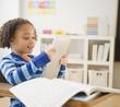 African American girl looking at digital tablet