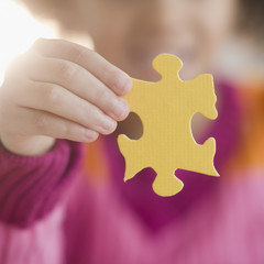 African American girl holding puzzle piece