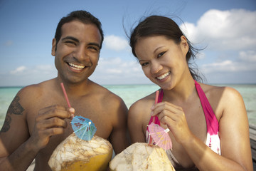 Couple drinking tropical cocktails